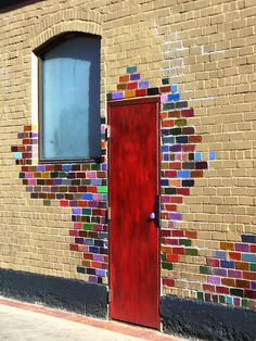 Painting bricks around your front door is a great way to express your artistic side and create visual interest. Door art. Doors. Curb appeal. City art.