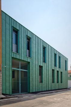 """The green finish applied to the metal cladding of this police station extension in Italy resembles oxidised copper, but also aims to evoke the """"power and invincibility"""" of The Incredible Hulk."""