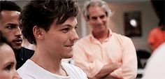 Gif Louis' reaction to Harry filming marcel