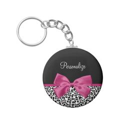 A trendy black and white leopard print keychain with a vivacious hot pink ribbon tied into a cute girly bow. Personalize this chic and stylish animal pattern design by adding the name of your teen girl. #sold