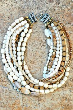 Like the colors.| XO Gallery. Bone, shell, pearls, brass, jasper, silver, wood, seeds.