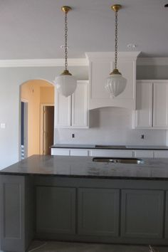 Island is BM - Duxbury Gray and the cabinets are White Dove - BM