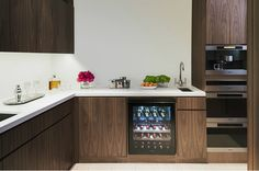 Dark wood in the kitchen, wine fridge, sleek white counters, Miele Appliances. Kitchen Items, Kitchen Dining, Kitchen Cabinets, Dining Room, Edition Hotel, Penthouse Suite, White Counters, Modern Kitchen Design, Pent House