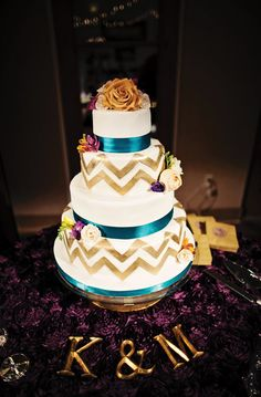 Teal and gold chevron cake by Madison's on Main.