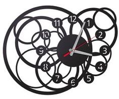Galactic clock will be a strong element in salon or hall despite smooth ornamental opening. It is a great idea for somebody who likes modern design. Lp Watches, Clock Art, Wall Clocks, Family Tree Wall Sticker, Unusual Clocks, House Ornaments, Wooden Clock, Scroll Saw, Modern Design