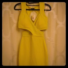 Yellow Mini Dress NWT yellow bodycon cutout dress. Features slip-on, deep v-neckline, bodycon fit, mini length. Polyester / Spandex mix. Perfect for a night out with the girls! Dresses Mini