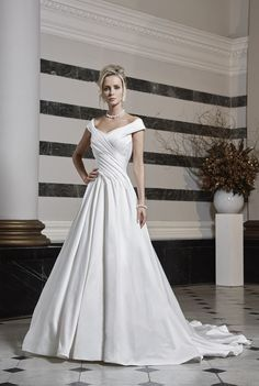 Timeless and gracefully elegant, this beautifully draped ball gown is reminiscent of the Hollywood glamour of the 50's.
