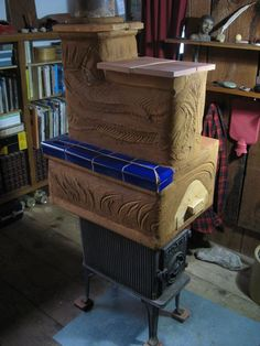 increase wood stove efficiency with bricks and mud; DIY home heating project includes construction photos and videos