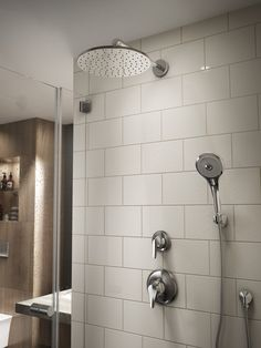 TOTO Rain Shower and Hand Shower sets paired with neutral tile create a refreshing space to begin the day. Bathroom Renos, Bathroom Fixtures, Bathroom Renovations, Bathroom Interior, Shower Set, Rain Shower, Bathroom Storage Shelves, Bathroom Organization, Bathroom Goals