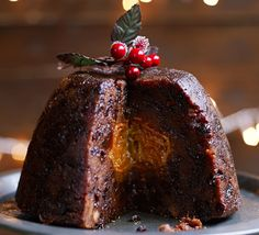 Impress your guests with this traditional, steamed pudding with a difference - cut to reveal a tender fruit centre and oozing citrus syrup