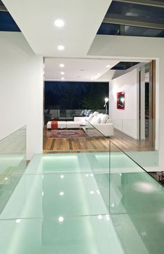 #GlassBridge over Atrium Foyer coolness...design inspiration for a living level over a Lost Mayan City space below.