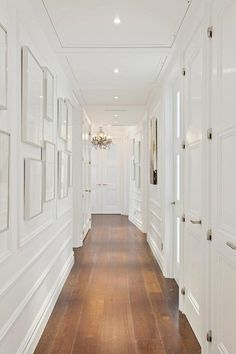 hallway decorating 427630927117845890 - A narrow hallway might seem considering a curse, yet it offers suitably much potential for interior beauty and practicality. look these creative suggestions Source by White Hallway, Hallway Walls, Long Hallway, Upstairs Hallway, White Walls, Modern Hallway, Wainscoting Hallway, Painted Wainscoting, Black Wainscoting