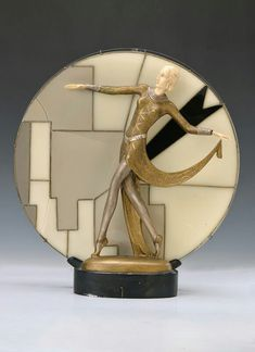 Table lamp, France, 1930s, Art-Deco, fully plastic figure of a pacing woman of metal cast, hands and head of Bakelite.