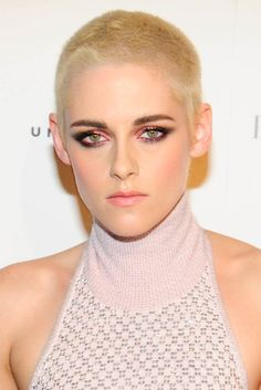 Kristen Stewart gave us major hair envy when she debuted this close shaved haircut. She balanced out the tomboy vibe with a feminine makeup look and a high neck pink dress.