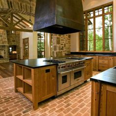 brick floor in the kitchen,  love the hood!  Looks beautiful, but not sure how practical it would be.