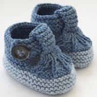 These cute little T-bar shoes have been knitted using lovely Sirdar cotton blend yarn in shades of denim blue and light blue. They are fastened with matching buttons. They are light and comfortable. Just right for wearing in the buggy or car seat. ...