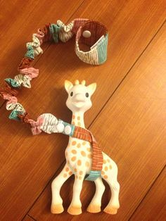 http://www.babytoys6months.com/category/sophie-the-giraffe/ Modern Stripes Sophie the Giraffe and Toy Leash by LJBabyDesigns