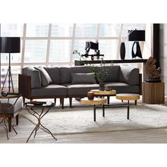 A comfortable and cool design, this sofa will find its way into urban, transitional and industrial spaces. The grey upholstery goes with a variety of decor styles. Modern Home Furniture, Modern Sofa, Sofa Furniture, Furniture Deals, Living Room Furniture, Living Rooms, Modular Couch, Cool Couches, Apartment Sofa