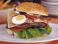 Chivito - National dish of Uruguay. Sandwich of filet mignon, mozzarella cheese, tomatoes, bacon, eggs and ham served with french fries.