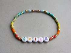 Rainbow SMILE Bracelet Mixed Beads I can make the bracelet to your size. Just send me a message or you will receive a standard size bracelet. Handmade Beaded Jewelry, Earrings Handmade, Diy Jewelry, Jewelery, Jewelry Accessories, Jewelry Design, Jewelry Making, Letter Bead Bracelets, Beaded Bracelets
