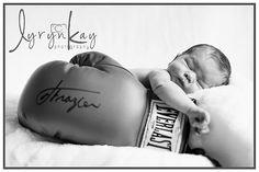 Newborn photography, newborn boy photography, newborn with boxing glove, newborn posed, Newborn photo shoot.  Lyryn Kay photography
