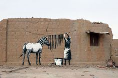 Banksy - This piece has significance, the women and her zebra ridden with poverty. #banksy http://www.widewalls.ch/artist/banksy/