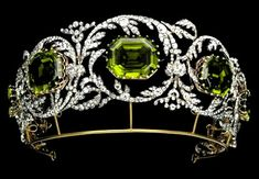Austrian Peridot Tiara created in the 1820s by Kőchert, the Imperial jewelers. This tiara is part of a parure (tiara, necklace, earrings and brooch) which was sold to Fred Leighton Jewelers in 2001. Links on source to close ups and pictures of more recent use of select pieces at The Golden Globe Awards. (Alt pin with 7 surmounts below)