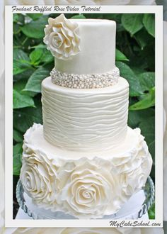 In this cake video tutorial, learn the art of ruffled roses and other elegance designs.
