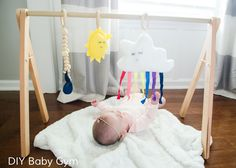 DIY Baby Gym Tutorial with Free Patterns for the hanging toys (rainbow cloud, sun, etc) found on CraftaholicsAnonymous.net
