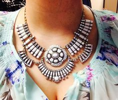 Patterned top + statement jewelry