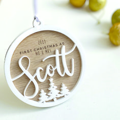 The perfect personalised decorative gift to celebrate the first Christmas married together. This large high quality bauble is beautifully crafted and engraved with writing and trees. The bauble is personalised with the couples names, and finished off with a loop of white ribbon.  Presented in our luxury signature gift box. #christmas #bauble #together #justmarried #personalisedchristmas #christmasdecoration #christmastree #personaliseddecoration #christmasgift #christmasbauble 3d Christmas, Christmas Crafts For Gifts, Christmas Baubles, Craft Gifts, Laser Cutter Ideas, Laser Cutter Projects, Laser Art, Laser Cut Wood, First Christmas Married