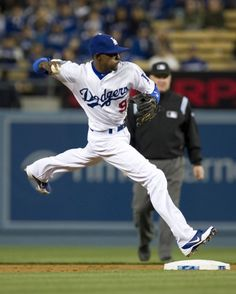 Dee Gordon throws on the run to first during game against the San Diego Padres Saturday, April 14, 2012 at Dodger Stadium
