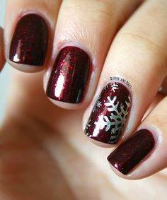 deep red nails with silver snowflake accent