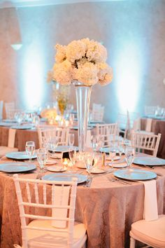 This bride wanted to mix modern with vintage and with the help of Busy Bride Wedding Design and Lee Forrest Design LLC , the Tiffany blue decor and white bouquets made for a classic look! Our white Chiavari chairs and uplighting were used, too! The 1920s trend is popping back up in the industry, so check out the other photos courtesy of Shipra Panosian Photography! http://wp.me/p2XAl4-GR