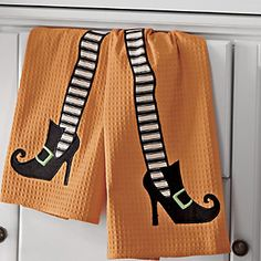 Set of 2 Wicked Fun Towels | Get into the spirit—even when you're drying dishes. Waffle weave towels have appliquéd witch legs edged with embroidery.  http://www.countrydoor.com/Set-Of-2-Wicked-Fun-Towels.pro?omSource=SLI