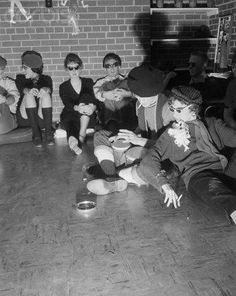 - bongo beating bohemian beatniks with their berets and turtlenecks. (Late '50s)