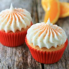 orange cupcakes with vanilla cream cheese frosting