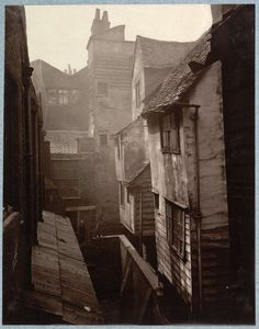 Cloth Fair - Old London -1880 Cloth Fair derived its name from the famous Bartholomew Fair, held within the precinct of the Priory.  Photographer: Henry Dixon