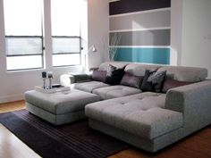 HGTV fanmodern123 limited the use of stripes to one section of the back wall in this simple and modern living room. The result is a super-chic space with varying shades of gray and a vibrant hit of turquoise.