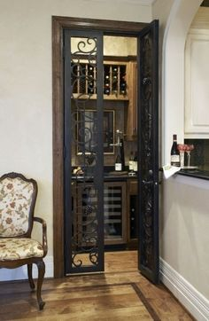 This converted closet for a wine room just off the kitchen is a great idea. Love the wrought iron doors! Converted Closet, Petits Bars, Home Interior, Interior Design, Attic Design, Wine Cellar Design, Industrial Interiors, Industrial Door, Warm Industrial