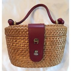 """Vintage Etienne Aigner Nantucket Basket Purse Beautiful vintage Nantucket basket style purse with oxblood leather details. Turn lock closure, brass detailing and feet. Unique knotted handle. Open pocket inside. Handmade. Great condition with a slight white mark on front. 8.5""""Wx5.5""""Hx6""""deep 5"""" drop Vintage Bags"""