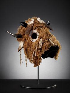Lakota buffalo horse mask, ca. 1860. South Dakota or North Dakota. Eagle and grouse feathers, pigment, buffalo horn, buffalo hide, rawhide, and cotton thread. Photograph by Walter Larrimore, NMAI. (11/4898)