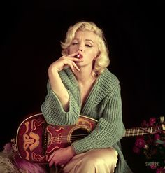 "September 2, 1953. Los Angeles, California. ""Marilyn Monroe with mandolin."" Color transparency by Milton H. Greene for Look magazine."