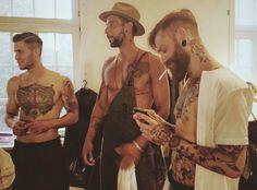 Backstage at runway show of @gabriel.franz.trauth // #contemporaryworkwear #apron #leatherspraps #frontcooking #manufacturer   #workdress #restaurantdesign #gastrodesign #brigade #Schürze #modernapron #craftmen #artists  #servicewear #modernkitchen #chefjacket #hotellerie #foodandwine #chefsroll #trauthfabrikate #trauth22 #tattooer #tattoos #skin Modern Aprons, Restaurant Design, Wine Recipes, Gabriel, Backstage, Work Wear, Chef Jackets, Runway, Dresses For Work