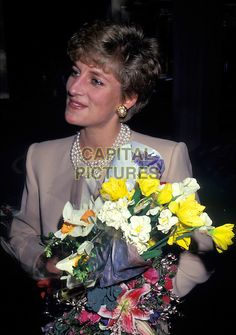 Beautiful Diana, I've never seen this photo of her. 》》》》》》》     HRH, THE PRINCESS DIANA OF WALES.London, England..Lady Di family her royal highness half length flowers.Ref: CAP/PL.©Phil Loftus/Capital Pictures