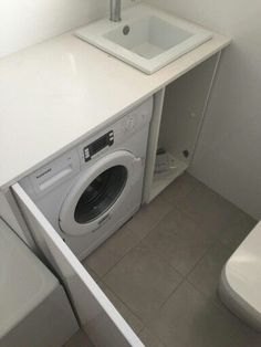 Bathroom renovation in progress - Hidden washing machine in our 'European laundry' has been installed in a custom vanity.