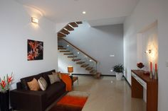 Family room with cantilevered staircase   - Interior designers bangalore projects | professional interior design company Bangalore | Modern and Retail Interior Designers | Residential Interior Designers | commercial interior designers bangalore
