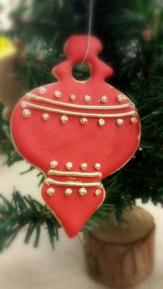 Red Christmas Ornament Sugar Cookie.  Crisp, buttery and individually hand decorated so no two are exactly alike.