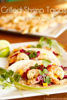 Grilled Shrimp Tacos with Spicy Mango Slaw -- these grilled shrimp tacos are as flavorful as they are beautiful, perfect for Cinco de Mayo!