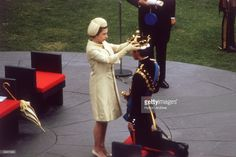 Queen Elizabeth II crowns her son Charles, Prince of Wales, during an investiture ceremony at Caernarvon Castle.